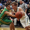JAY YOUNG | THE GOSHEN NEWS<br /> Wawasee sophomore Bennett Hoffert dribbles past Tippecanoe Valley freshman Tanner Trippiedi  during the quarterfinals of the 3A sectional Tuesday night at Wawasee High School in Syracuse.