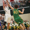 JAY YOUNG | THE GOSHEN NEWS<br /> Wawasee senior Tyler Smith (14) is hit on the arm as he pulls down a high pass in front of Tippecanoe Valley senior Jarod Duzenberry (40)  during the quarterfinals of the 3A sectional Tuesday night at Wawasee High School in Syracuse.