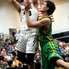 JAY YOUNG | THE GOSHEN NEWS<br /> Wawasee junior Trevon Coleman, left, forces up a shot over Tippecanoe Valley senior Jarod Duzenberry during the quarterfinals of the IHSAA Class 3A Boys Sectional Tournament Tuesday at Wawasee High School in Syracuse.