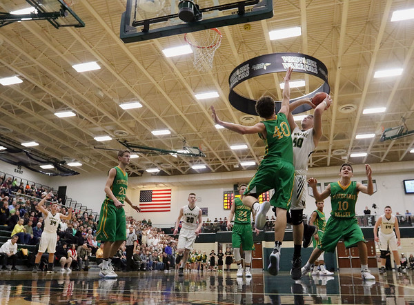 JAY YOUNG   THE GOSHEN NEWS<br /> Wawasee junior Trevon Coleman (40) shoots over Tippecanoe Valley senior Jarod Duzenberry (40) during the quarterfinals of the 3A sectional Tuesday night at Wawasee High School in Syracuse.
