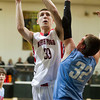 SAM HOUSEHOLDER | THE GOSHEN NEWS<br /> NorthWood senior Will Stueve shoots over Lakeland defender Chandler Mynhier Wednesday during the 3A Sectional at Wawasee High School.