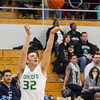 SAM HOUSEHOLDER| THE GOSHEN NEWS<br /> Concord junior Brett Austin shoots a three point shot against Elkhart Central Tuesday.