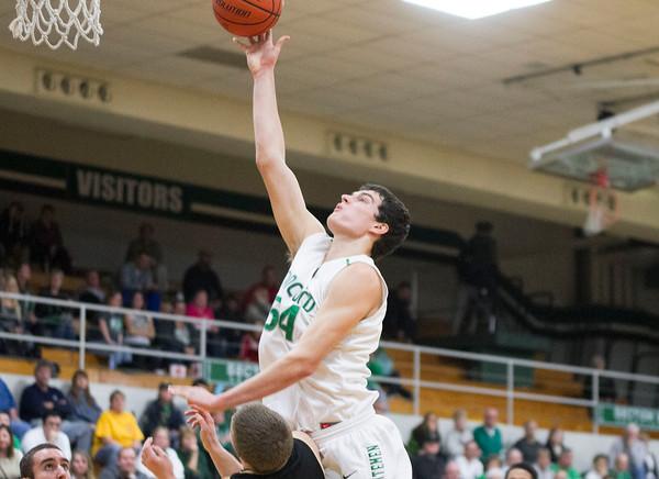 SAM HOUSEHOLDER | THE GOSHEN NEWS<br /> Concord senior Filip Serwatka shoots the ball over a Penn player during the game Friday.