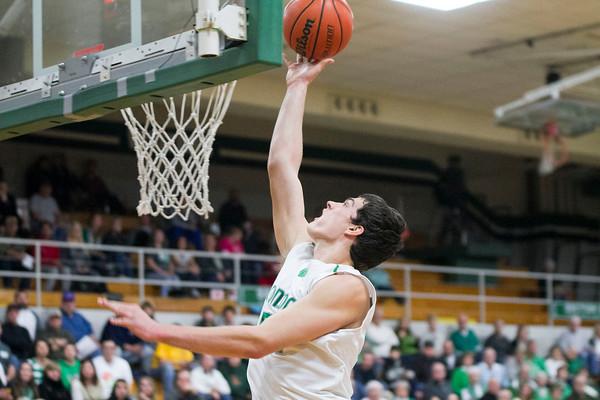 SAM HOUSEHOLDER   THE GOSHEN NEWS<br /> Concord senior Filip Serwatka shoots a basket during the game against Penn Friday.