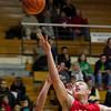 SAM HOUSEHOLDER   THE GOSHEN NEWS<br /> Goshen junior Austin Woolett shoots during the game against Elkhart Memorial Friday at Northside Gymnasium in Elkhart.