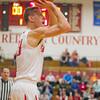 SAM HOUSEHOLDER | THE GOSHHEN NEWS<br /> Goshen senior Deric Haynes shoots a three point shot against Elkhart Central Saturday at Goshen High School during the home opener.