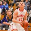 SAM HOUSEHOLDER | THE GOSHEN NEWS<br /> Goshen junior forward Austin Woolett drives to the basket during the home opener against Elkhart Central Saturday at Goshen High School.