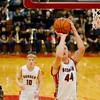 SAM HOUSEHOLDER | THE GOSHEN NEWS <br /> Goshen senior Austin Woolett shoots the ball during the game against Elkhart Memorial Friday. Goshen lost to Memorial 42-37.