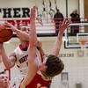 SAM HOUSEHOLDER | THE GOSHEN NEWS<br /> NorthWood sophomore Vincent Miranda goes up for a basket over Westview junior Chase Anderson during the game Thursday.