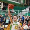 SAM HOUSEHOLDER | THE GOSHEN NEWS<br /> Northridge junior Brock Downey puts up a lay up against Elkhart Memorial Wednesday.