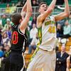 SAM HOUSEHOLDER | THE GOSHEN NEWS<br /> Northridge senior Nate Ritchie shoots over Elkhart Memorial junior Cameron Maxwell during the game Wednesday.