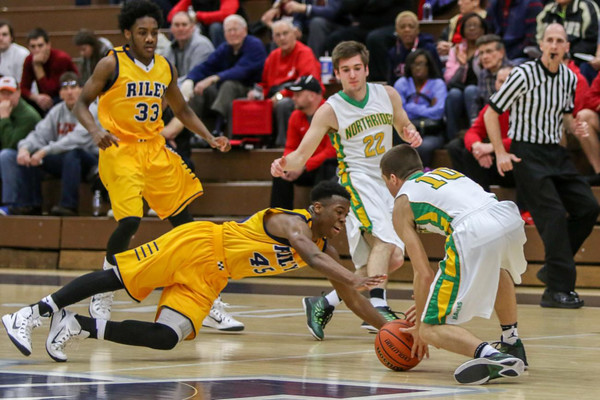 RUSS DRAPER | SPECIAL TO THE GOSHEN NEWS<br /> South Bend Riley's Reontre Lawrence and Northridge's Collin Utley struggle for a loose ball as Northridge's Payton Carson (22) and Rile's Jadon Grundy (33) look on Saturday afternoon during the 4A Michigan City Regional semifinal. The Raiders fell 71-56.