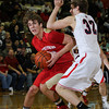 CHAD WEAVER   THE GOSHEN NEWS<br /> Westview junior Candler Aspy goes to the basket against Lewis Cass senior Drew McRae during the first half of Saturday's 2A semi-state at Huntington North High School. Westview won 65-58.
