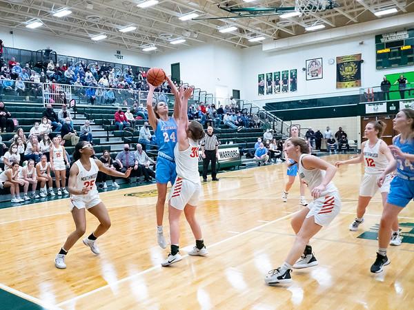 Lakeland forward Baily Hartsough (24) shoots a basket during Saturday's game at Wawasee High School in Syracuse.