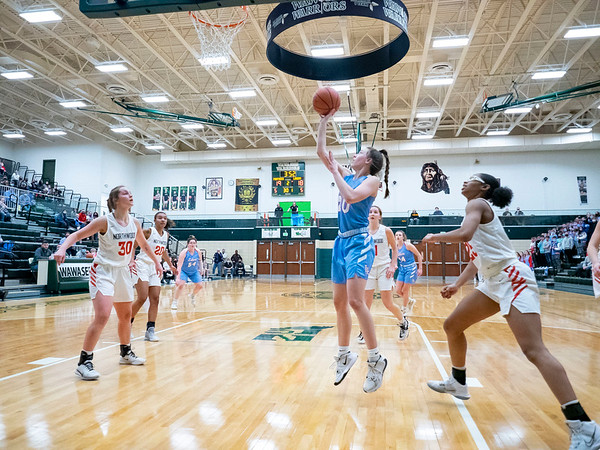 Lakeland guard Alivia Rasler (20) shoots a basket during Saturday's game at Wawasee High School in Syracuse.