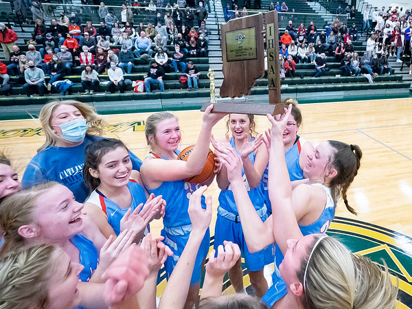 Lakeland  Lakers girls basketball team hold up the IHSAA 2021 Class 3A Girls Basketball Sectional Championship trophy after Saturday's game at Wawasee High School in Syracuse.