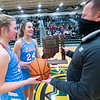 Lakeland forward Baily Hartsough (24) and forward Madison Keil (32) receive the game ball and IHSAA 2021 Class 3A Girls Basketball Sectional Championship trophy  after Saturday's game at Wawasee High School in Syracuse.