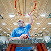 Lakeland head coach reacts after cutting the net after Saturday's game at Wawasee High School in Syracuse.