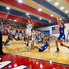 West Noble Chargers senior Lillian Mast (24) shoots a basket against Bethany Christian Bruins senior Mia Reinhardt (12) during Thursday's game at West Noble High School in Ligonier.