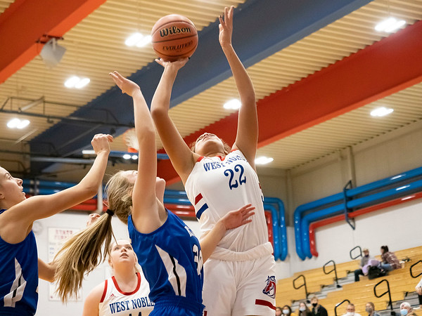 West Noble Chargers junior Jazmyn Smith (22) goes up for a basket during Thursday's game at West Noble High School in Ligonier.