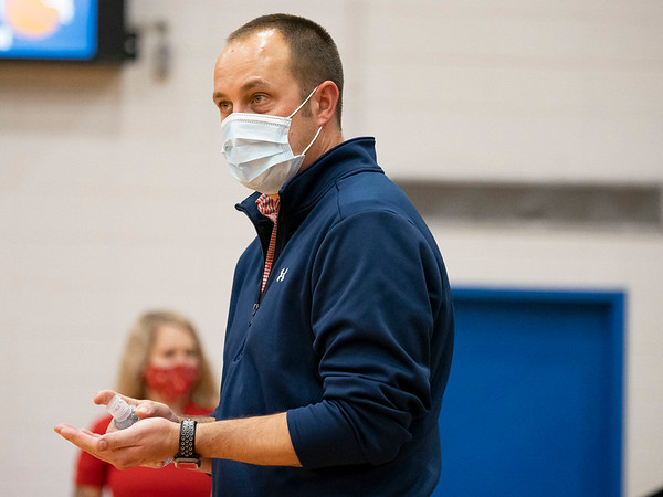 West Noble Chargers head coach Jeff Burns sanitizes his hands before Thursday's game at West Noble High School in Ligonier.