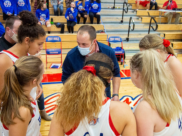 West Noble Chargers head coach Jeff Burns leads the team huddle before Thursday's game at West Noble High School in Ligonier.