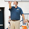 Fairfield Falcons head coach Brodie Garber communicates with his players during Friday's game at Fairfield Jr./Sr. High School in Benton.