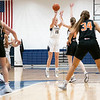Fairfield Falcons sophomore Brea Garber (15) shoots a basket during Friday's game at Fairfield Jr./Sr. High School in Benton.