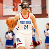 West Noble Chargers senior Lillian Mast (24) dribbles the ball down court during Tuesday's game at West Noble High School in Ligonier.