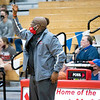 Goshen RedHawks head coach Shaun Hill communicates his players during Tuesday's game at West Noble High School in Ligonier.