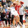 Goshen RedHawks junior Tori Eldridge (24) battles for the ball against West Noble Chargers senior sophomore Mackensy Mabie (12) during Tuesday's game at West Noble High School in Ligonier.