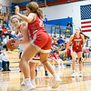 West Noble Chargers senior Angela Caldwell (44) looks to pass the ball to her teammate against Goshen RedHawks freshman Kyra Hill (21) during Tuesday's game at West Noble High School in Ligonier.