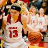 Goshen junior Alyssa Hershberger drives to the basket during the sectional championship game against Warsaw at Goshen High School Monday February 16, 2015. Goshen lost 39-33.