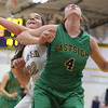 JAY YOUNG | THE GOSHEN NEWS<br /> Fairfield junior Katie Lashley (22) fights for rebounding position against Eastside junior Olivia Yoder (4) during their quarterfinal game in the NECC Basketball Tournament Wednesday night at Fairfield.
