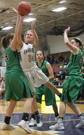 JAY YOUNG | THE GOSHEN NEWS<br /> Fairfield junior Felicity Bontrager (24) gets off a shot after slipping between Eastside defenders Olivia Yoder (4) and Lindsey Beard (10) during their quarterfinal game in the NECC Basketball Tournament Wednesday night at Fairfield.