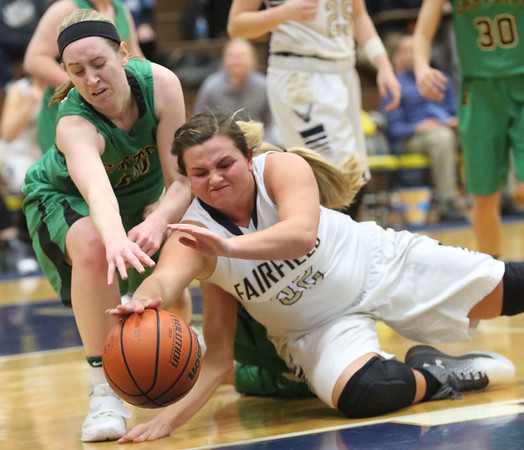 JAY YOUNG | THE GOSHEN NEWS<br /> Fairfield senior Alexis Thaxton, right, fights for a loose ball against Eastside junior Lindsey Beard during their quarterfinal game in the NECC Basketball Tournament Wednesday night at Fairfield.