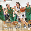 JAY YOUNG | THE GOSHEN NEWS<br /> Fairfield junior Drea Lockwood (20) is chased down by Eastside defenders Lindsey Beard (10), Hannah Yoder (30), and Maddisyn Heffley (22)  during their quarterfinal game in the NECC Basketball Tournament Wednesday night at Fairfield.