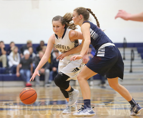 JAY YOUNG | THE GOSHEN NEWS<br /> Fairfield junior Jenean Schwartz, left, is pressured by Garrett senior Tori Baver as she brings the ball up the court during their game Tuesday night at Fairfield.