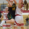 JAY YOUNG | THE GOSHEN NEWS<br /> Goshen High defender Josie Walters, right, stands her ground as she defends a shot by Northridge High senior Melinda Bontrager  during their game Friday night at GHS.