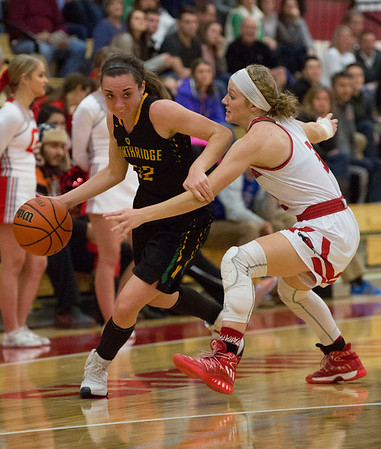 JAY YOUNG   THE GOSHEN NEWS<br /> Northridge senior Julaine Miller (12) uses her off hand to create space between herself and Goshen High junior Jillian Kissinger as she drives the ball during their game Friday night at GHS.