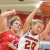 JAY YOUNG   THE GOSHEN NEWS<br /> Goshen sophomore Maggie Gallagher (20) rips down a rebound in front of West Noble junior Kasia Weigold (44) during their game Tuesday evening at GHS.