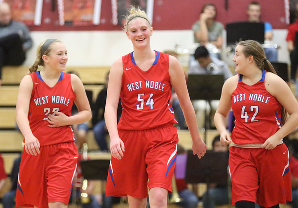 JAY YOUNG   THE GOSHEN NEWS<br /> West Noble players Kristina Teel (32), Kaylie Warble (54) and Angela Gross (42) are all smiles as they walk to their end of the court for free throws during the closing seconds of the fourth quarter of their game against Goshen High on Tuesday evening at GHS.