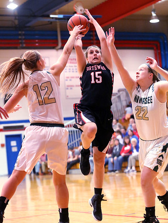 JAY YOUNG   THE GOSHEN NEWS<br /> NorthWood senior Nicole Flickinger (15) shoots over a double team by Wawasee's Kabrea Rostochak (12) and Hannah Haines (22) during their sectional game Tuesday night at West Noble High in Ligonier.