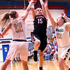 JAY YOUNG | THE GOSHEN NEWS<br /> NorthWood senior Nicole Flickinger (15) shoots over a double team by Wawasee's Kabrea Rostochak (12) and Hannah Haines (22) during their sectional game Tuesday night at West Noble High in Ligonier.