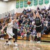 JAY YOUNG   THE GOSHEN NEWS<br /> Wawasee senior Hannah Haines (22) launches a three point shot over Northridge junior Meghan Cawood (32) during their game Tuesday night at Northridge Middle School.