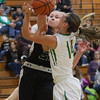 JAY YOUNG   THE GOSHEN NEWS<br /> Wawasee sophomore Casey Schroeder (20) goes for the block as Northridge sophomore Morgan Litwiller (14) takes a shot during their game Tuesday night at Northridge Middle School.