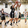 JAY YOUNG   THE GOSHEN NEWS<br /> Northridge senior forward Kelsey Brickner (44) goes up strong after getting past Wawasee  senior Aubrey Schmeltz during their game Tuesday night at Northridge Middle School.