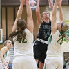 JAY YOUNG   THE GOSHEN NEWS<br /> Wawasee junior Hannah-Marie Lamie (14) shoots over Northridge defenders Ashley Beckler (42) and Brooke McKinley (20) during their game Tuesday night at Northridge Middle School.