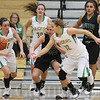 JAY YOUNG   THE GOSHEN NEWS<br /> Northridge junior Meghan Cawood (32) chases down the ball after swiping it away from Wawasee sophomore Casey Schroeder (20) during their game Tuesday night at Northridge Middle School.