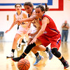 JAY YOUNG | THE GOSHEN NEWS<br /> Lakeland junior Karley Alleshouse, left, reaches over West Noble sophomore Lauren Burns to attempt to steal the ball away during their sectional game Tuesday night in Ligonier.